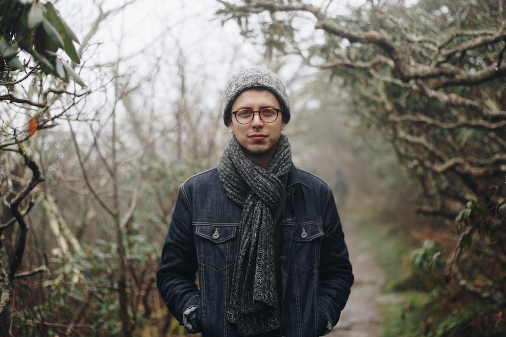 one unknown celebrity in black scarf