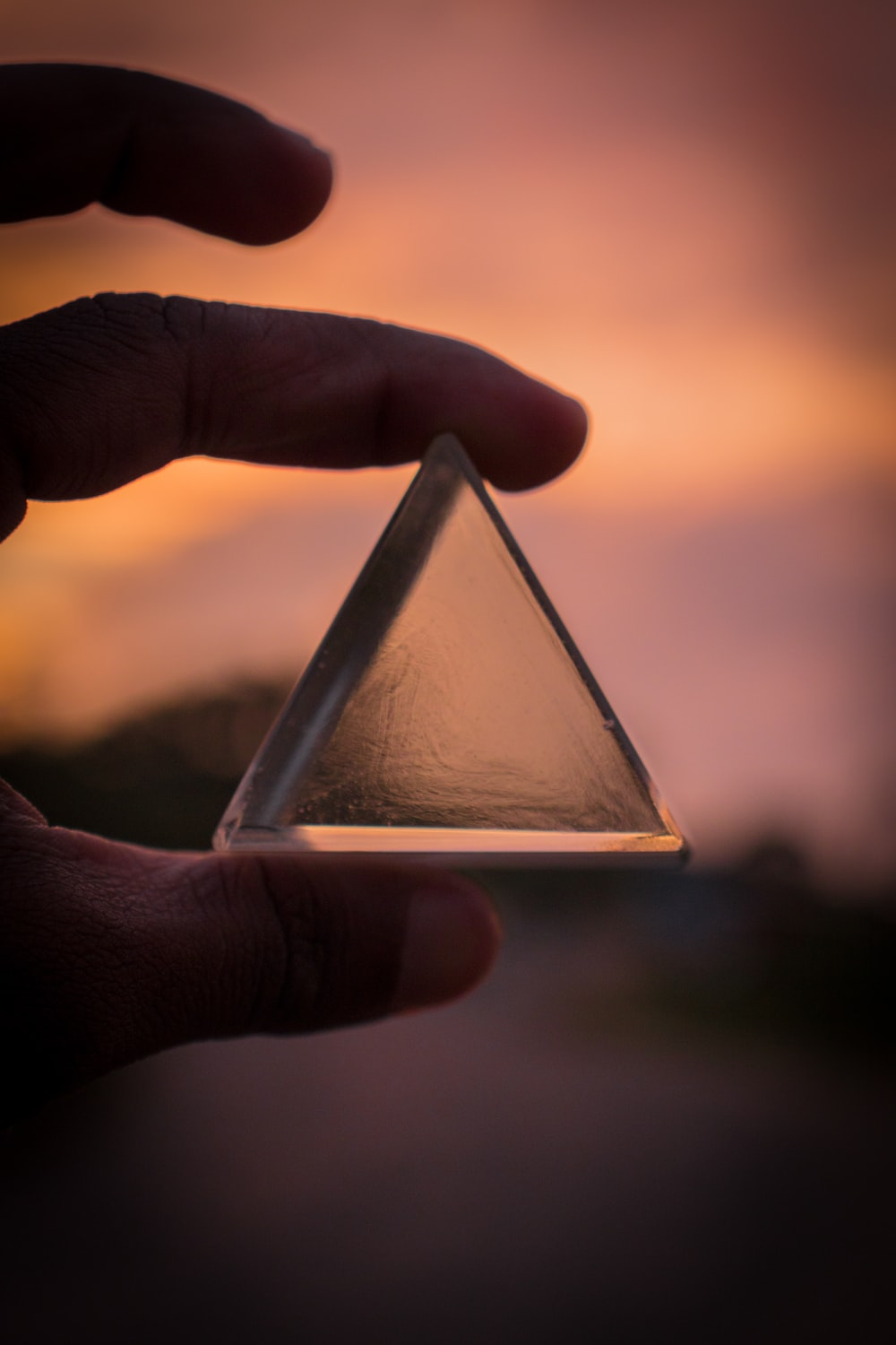 person holding triangle glass panel