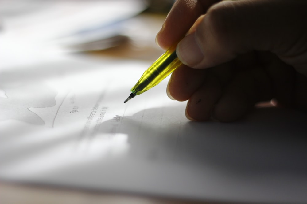 person about to write on piece of paper