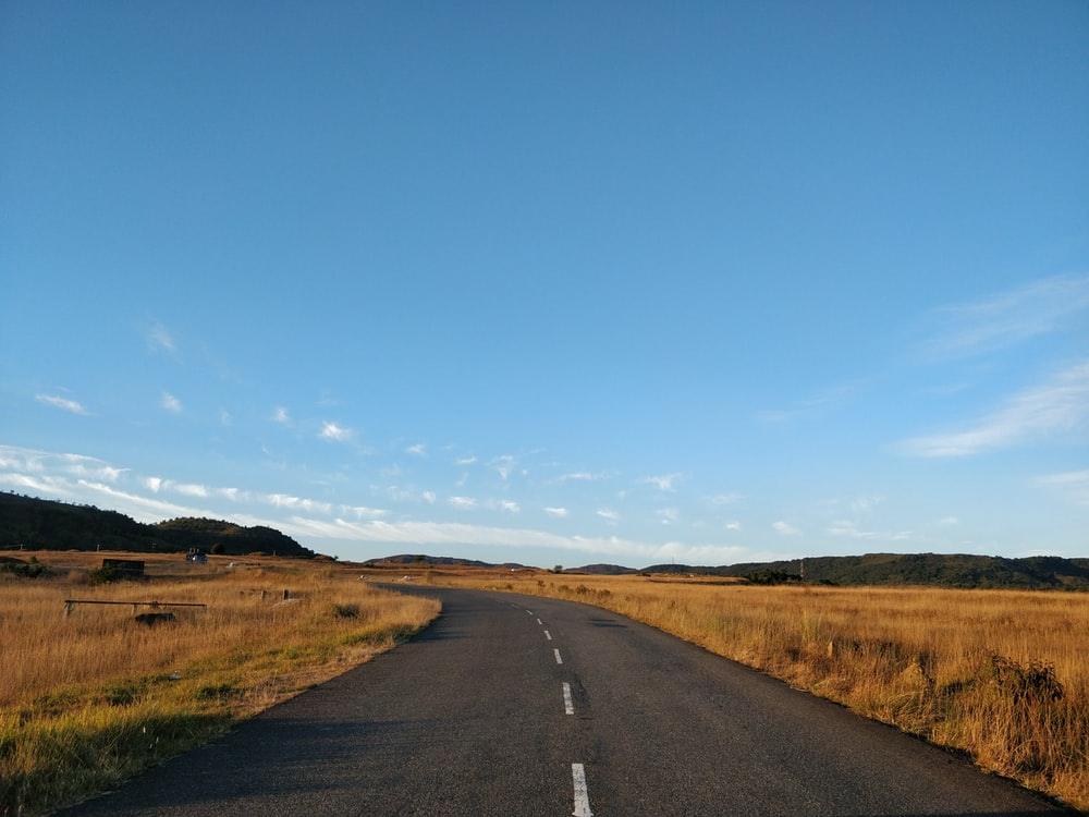 road and grass field
