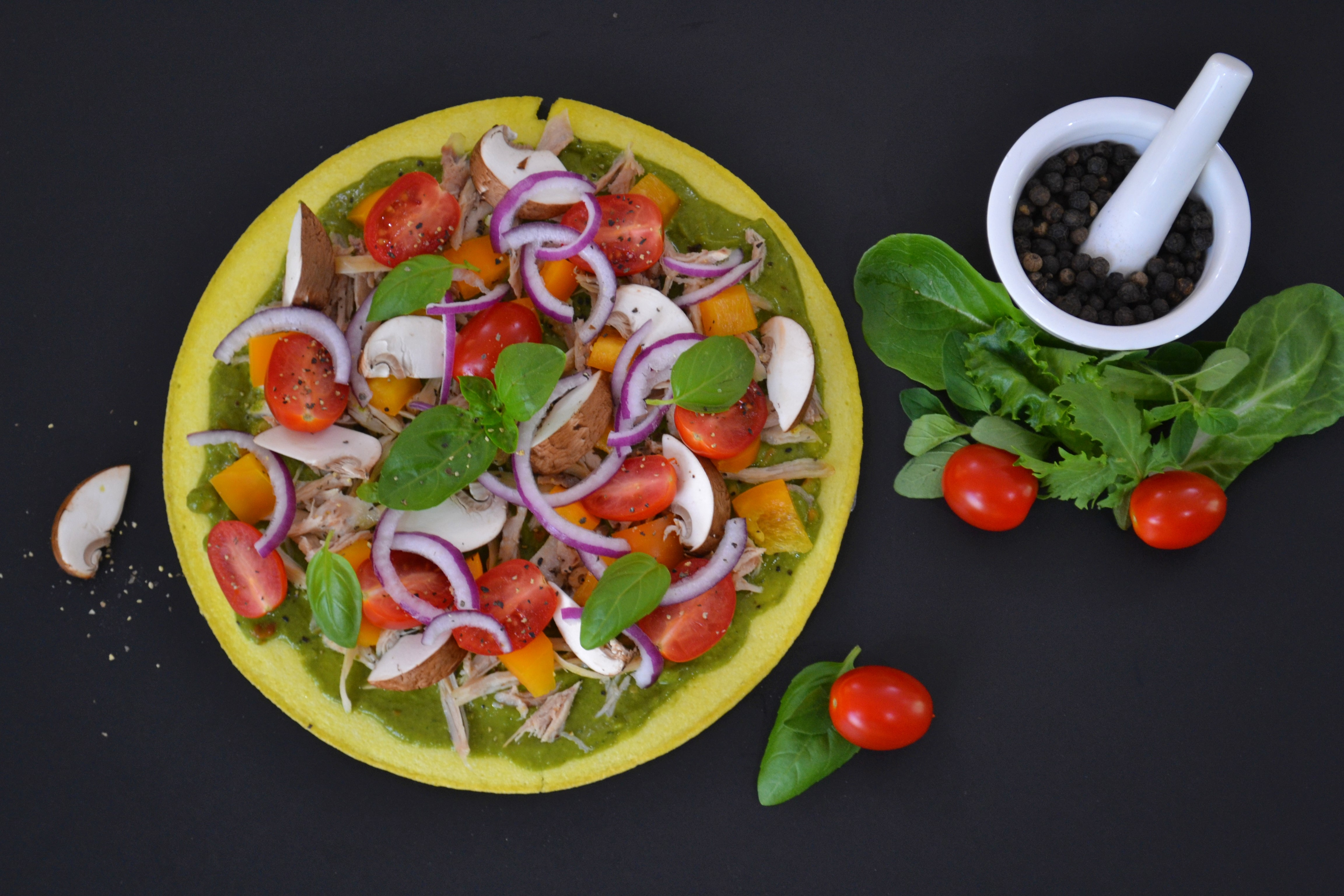 bowl of vegetables beside white cup