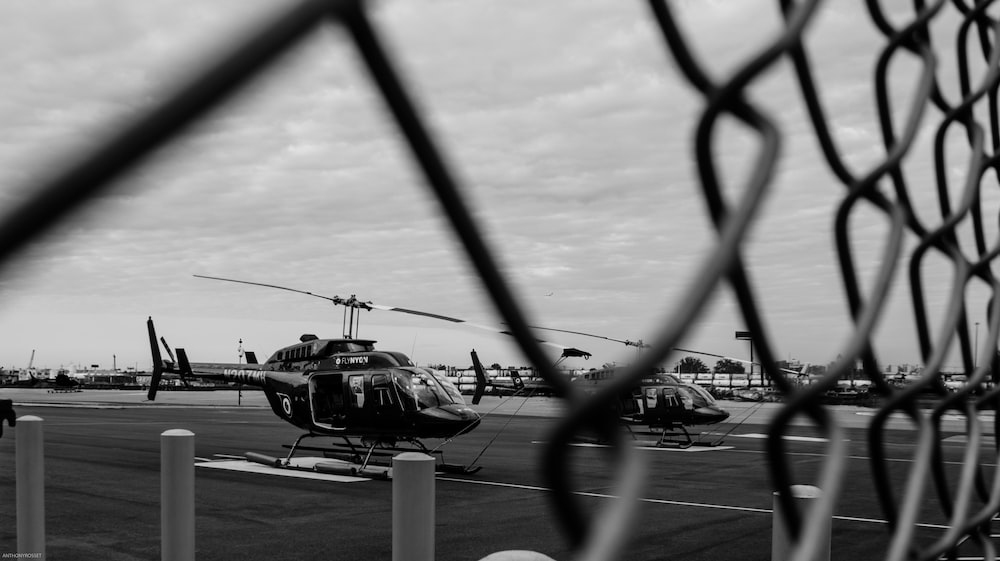 selective focus photography of black helecopter