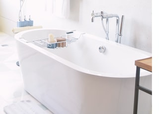 white drop-in bathtub near bath towel