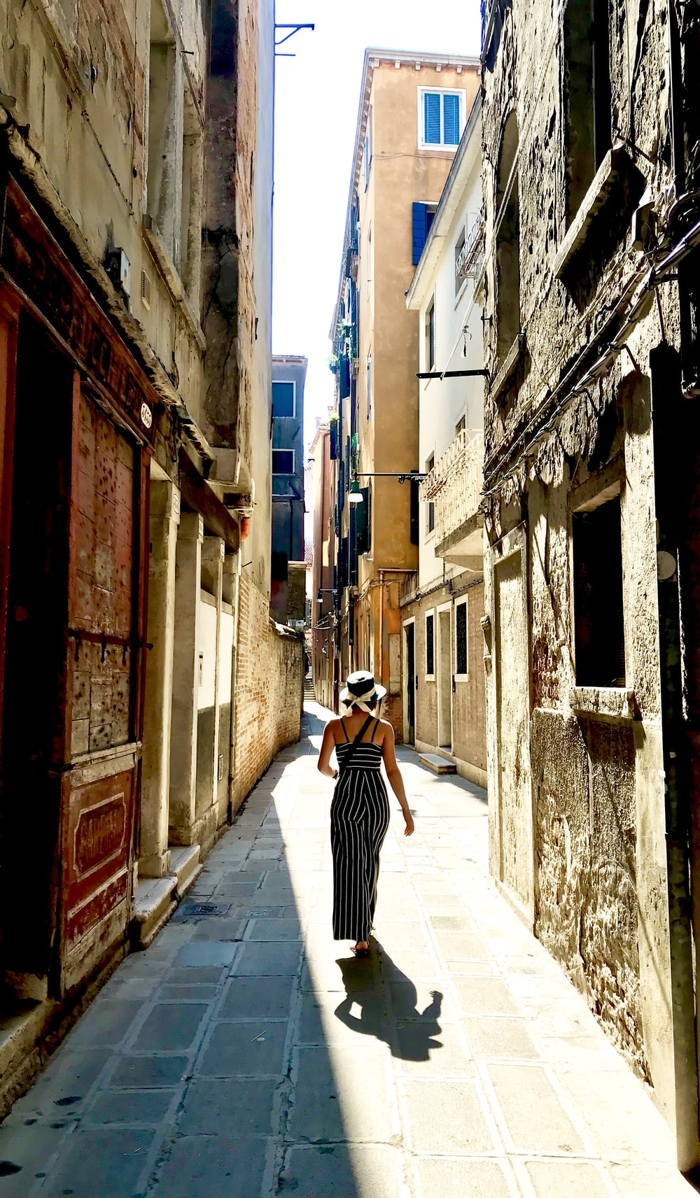 woman walking on alleway