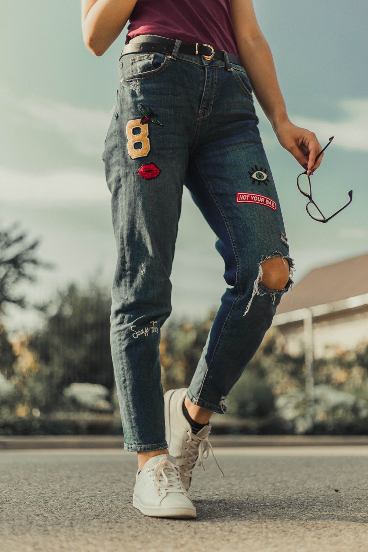 person wears blue jeans