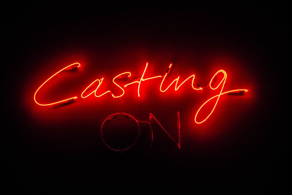 red Casting On neon light signage