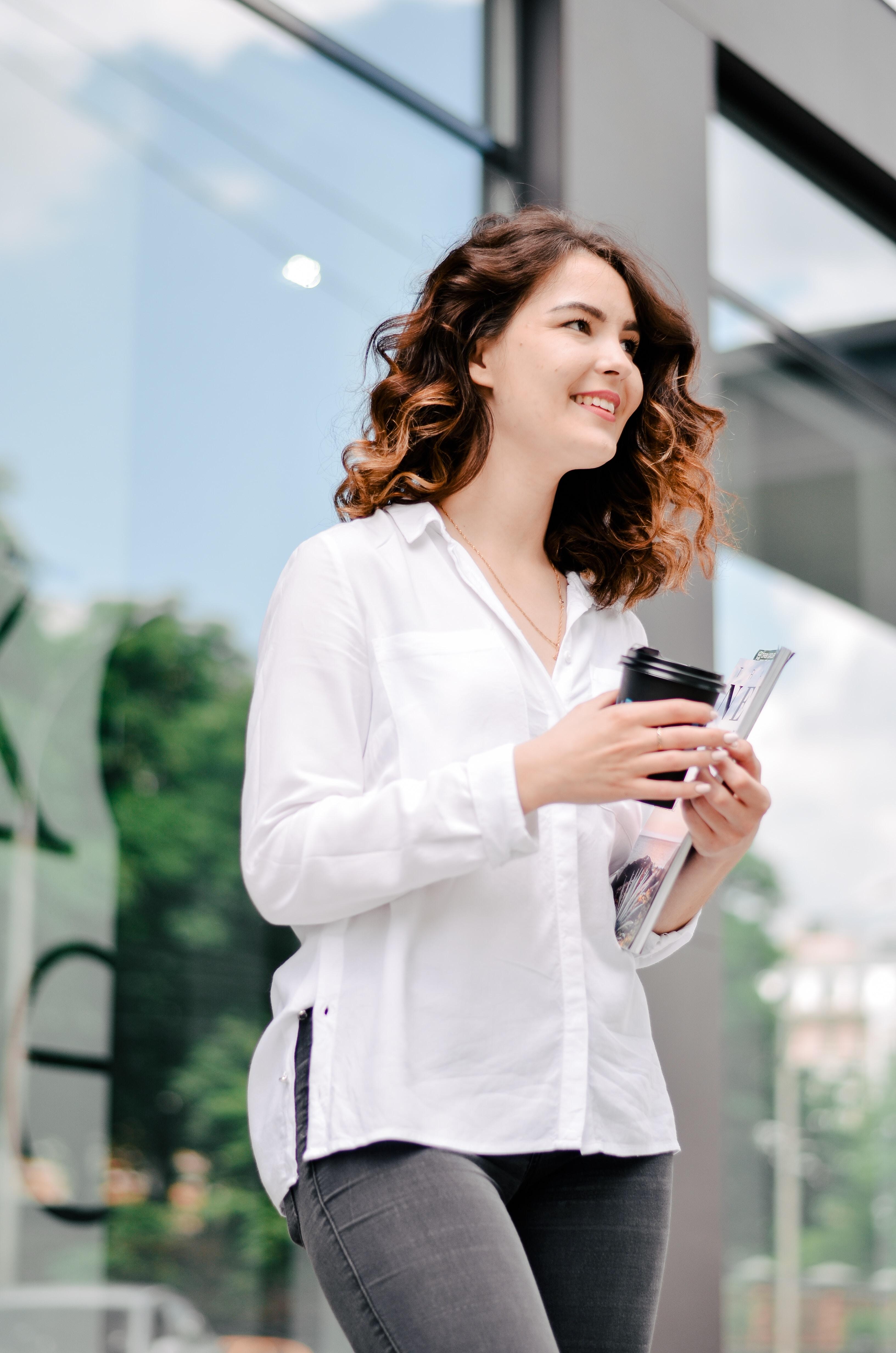 woman holding tumbler
