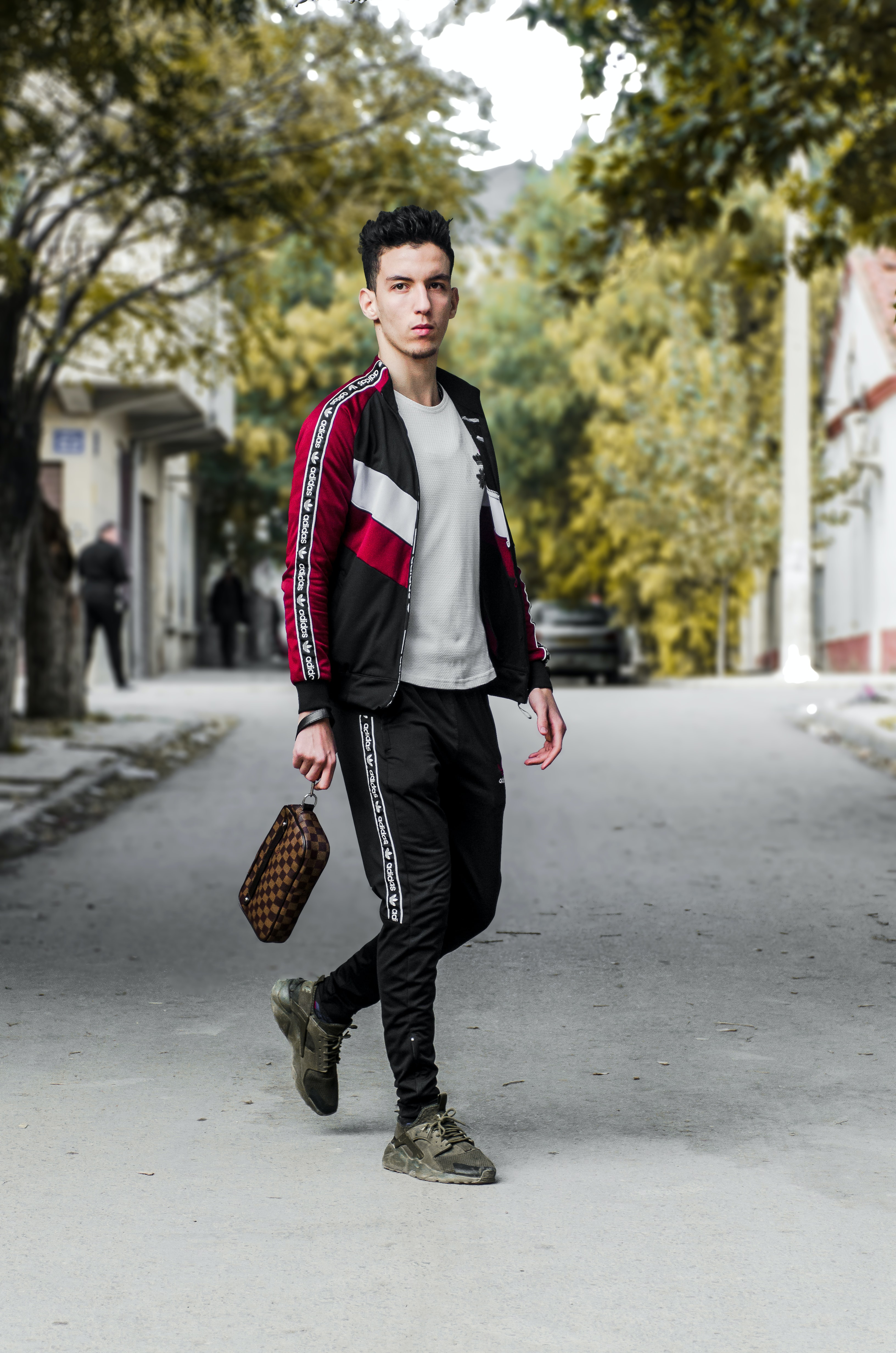 man wearing black and red jacket and black pants outfit