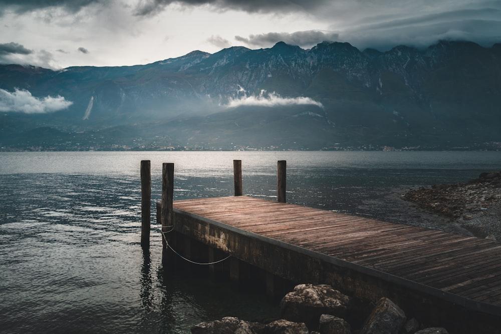 brown wooden dock near mountain