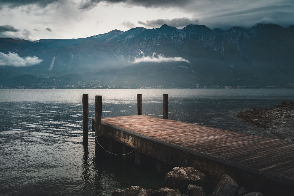 brown wooden dock near mountain