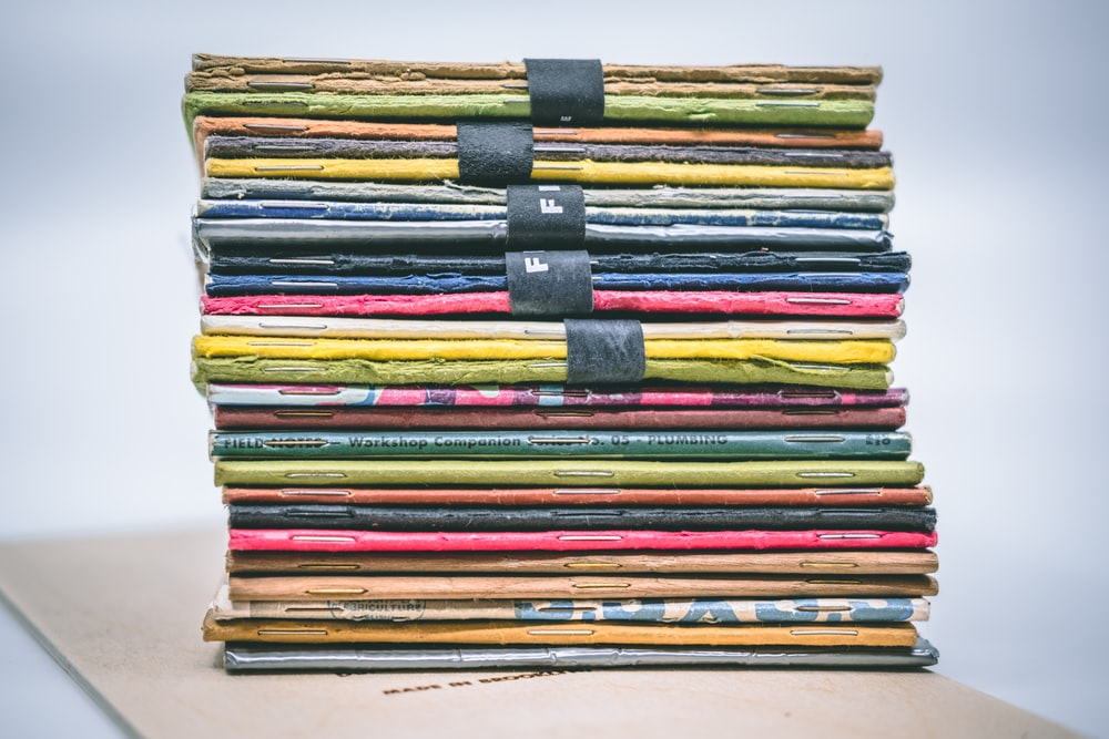assorted-colored stacked books