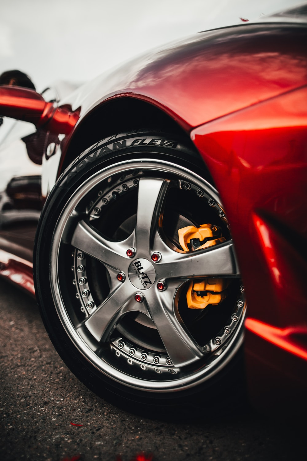 close-up photography of red sports car