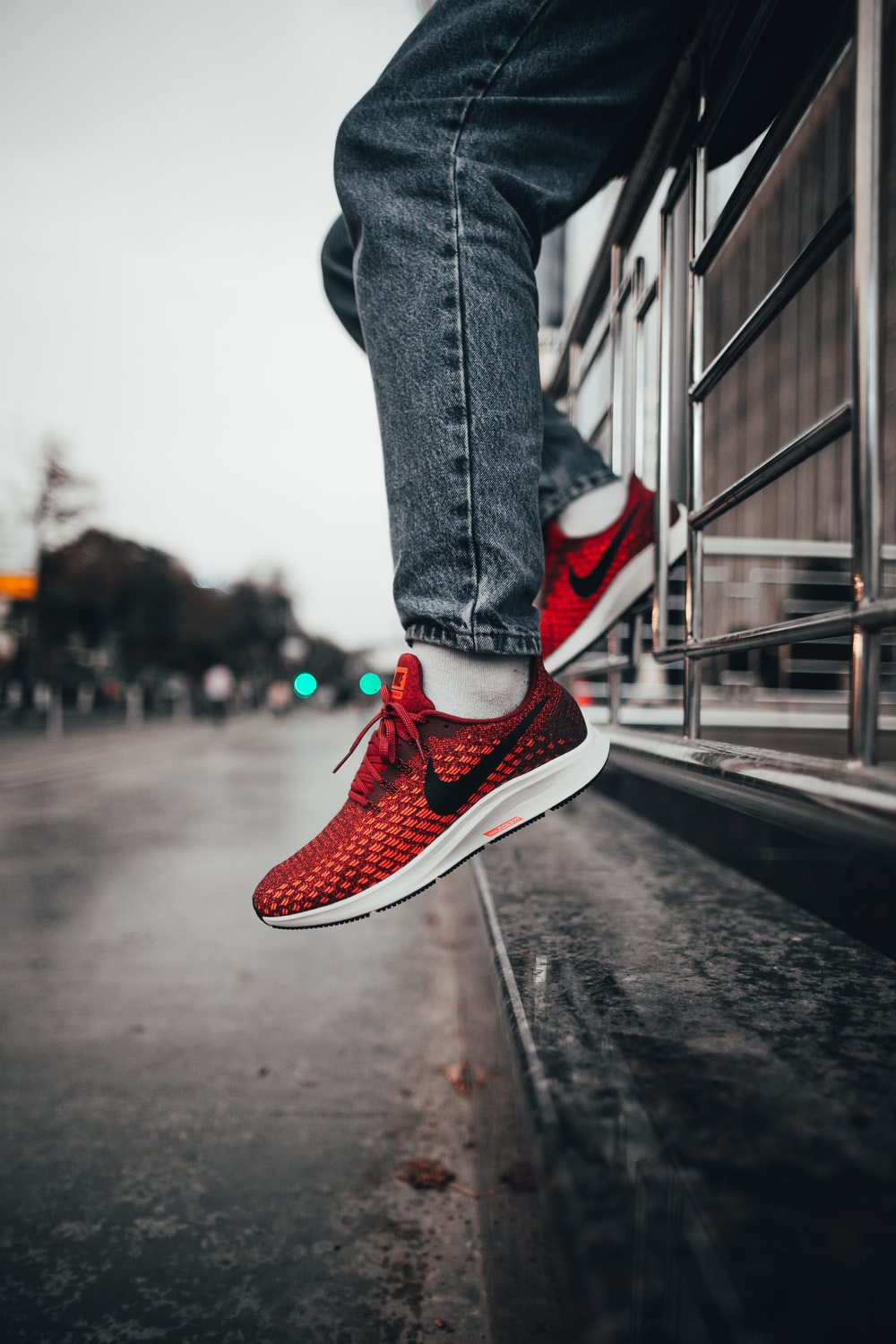person wearing red Nike sneakers