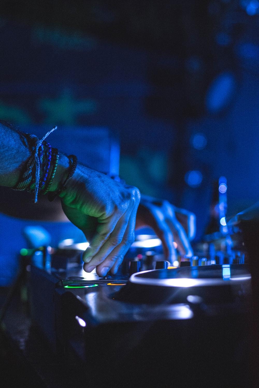 man controlling DJ controller