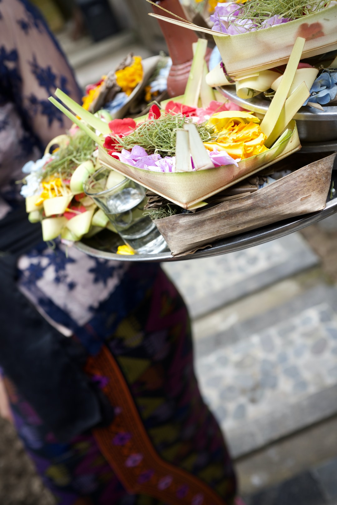 I was searching on Unsplash for frangipani/plumeria. I noticed only a handful of images. So, I plan to donate some of my photos of canang sari offerings starting with this special one.