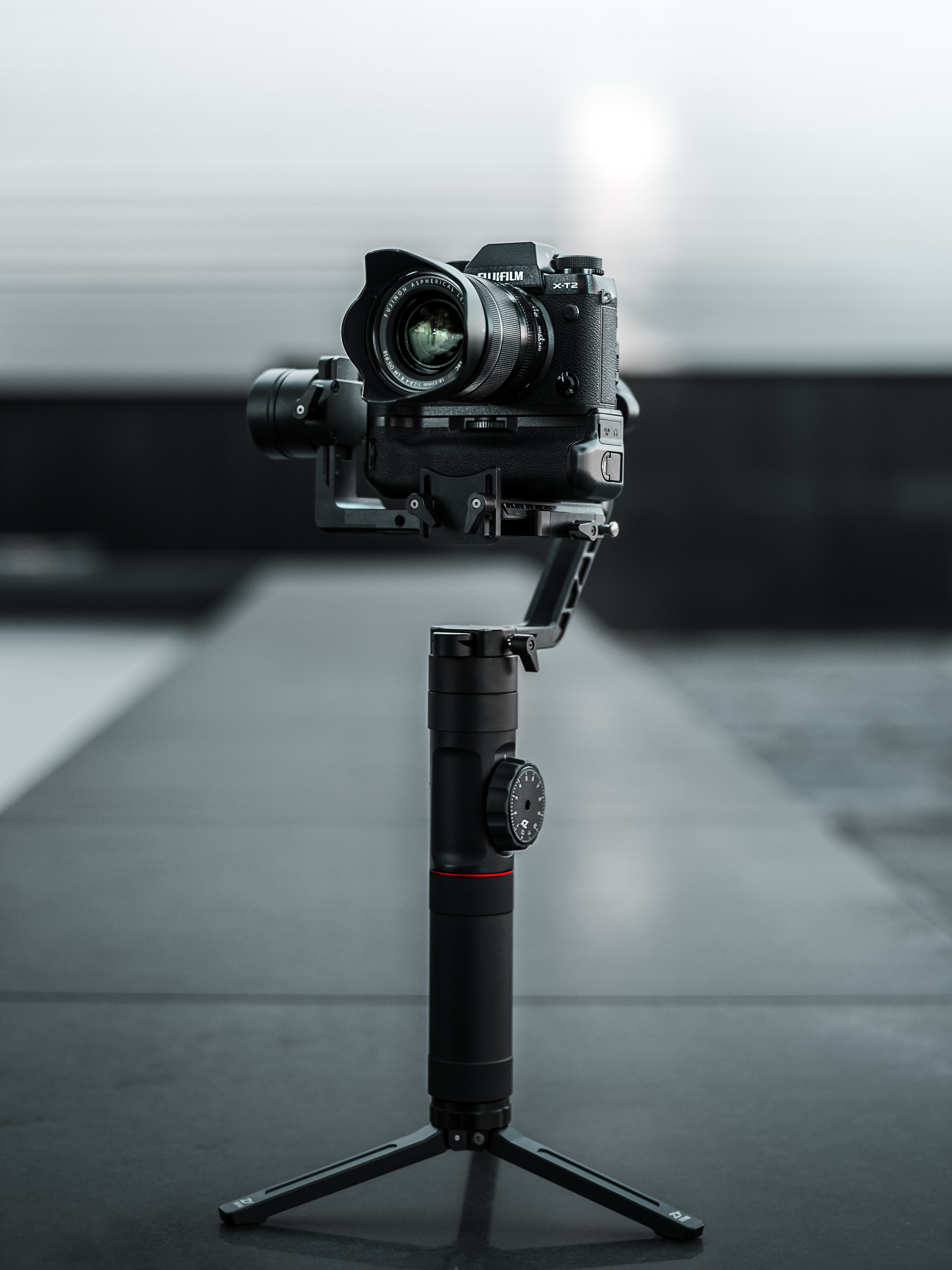 selective focus photography of black DSLR camera with camera tripod
