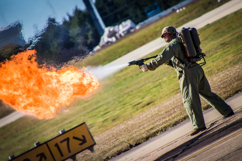 man holding flame thrower
