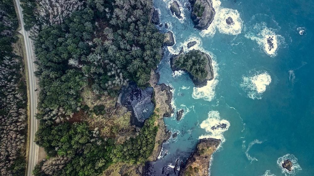 birds eye photography of body of water near mountain