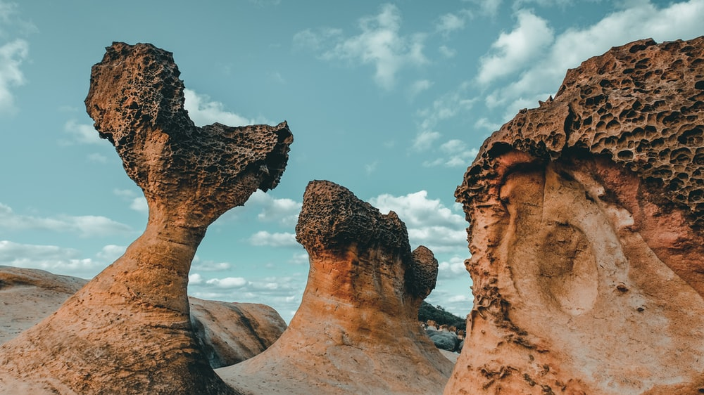 three brown rock formations