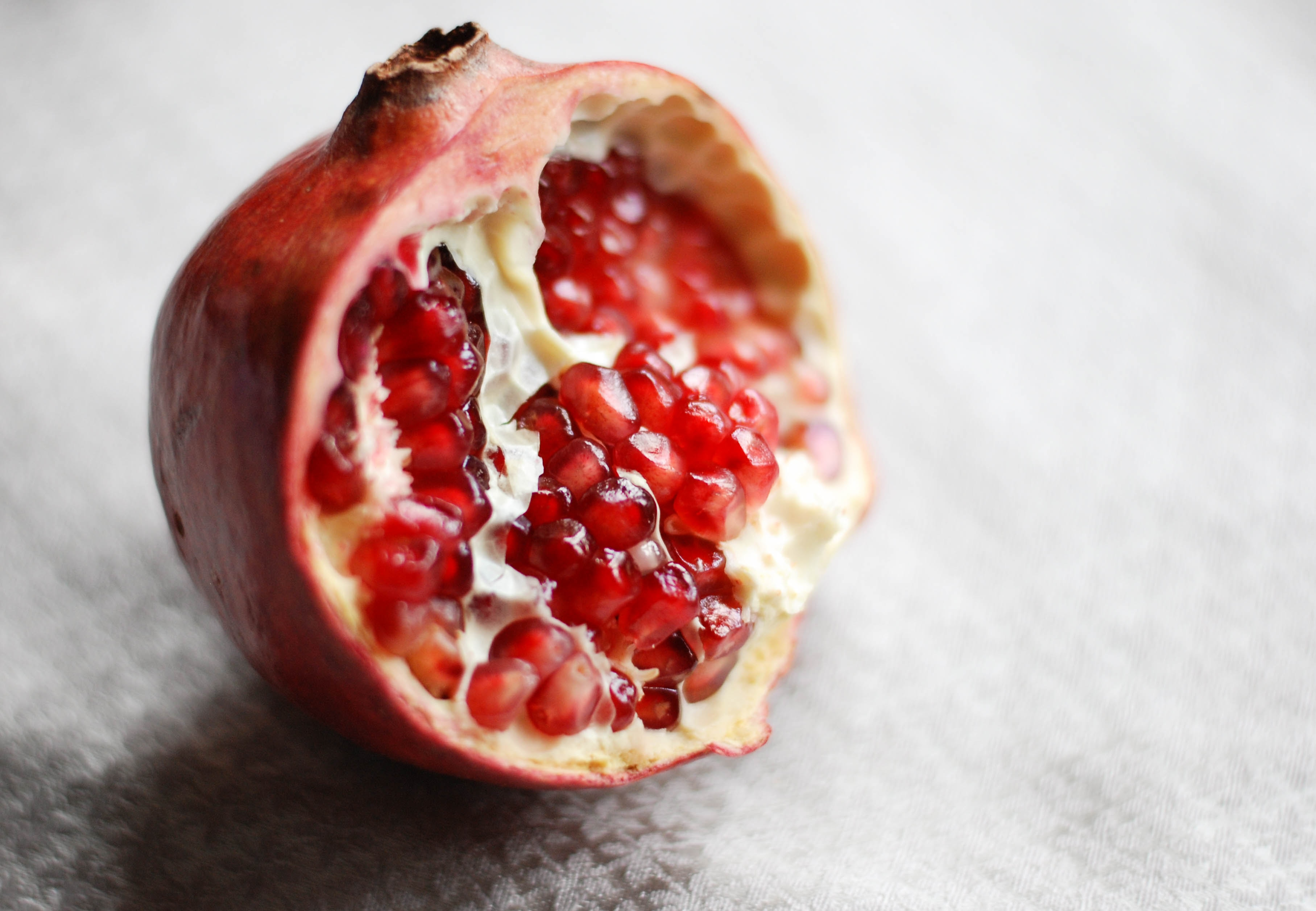 selective color photography of pomegranate