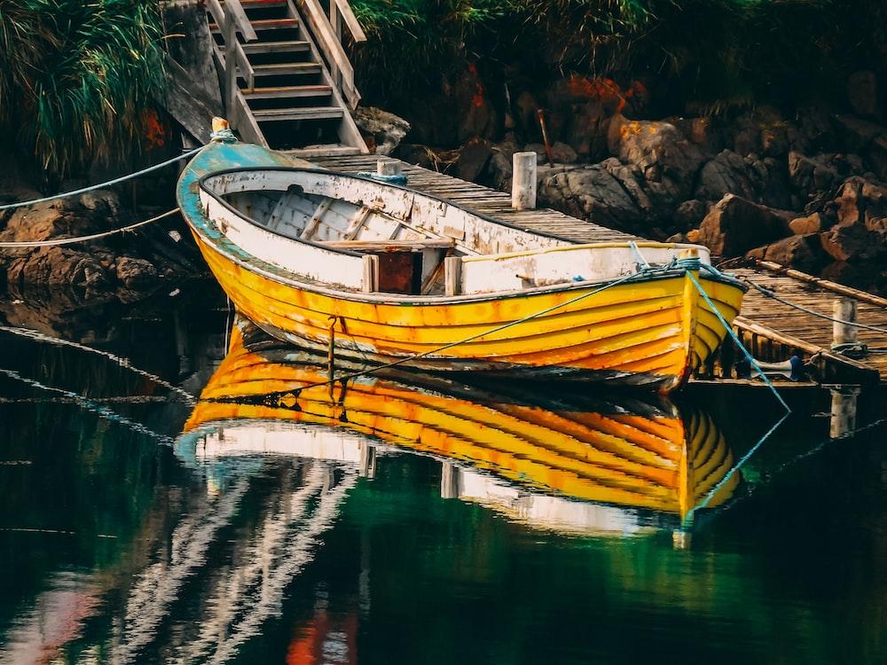empty yellow boat on dock