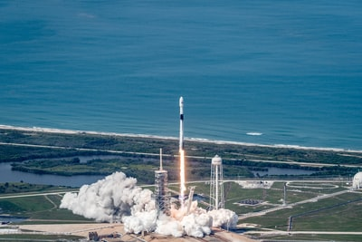 flying rocket on air at daytime launch day teams background