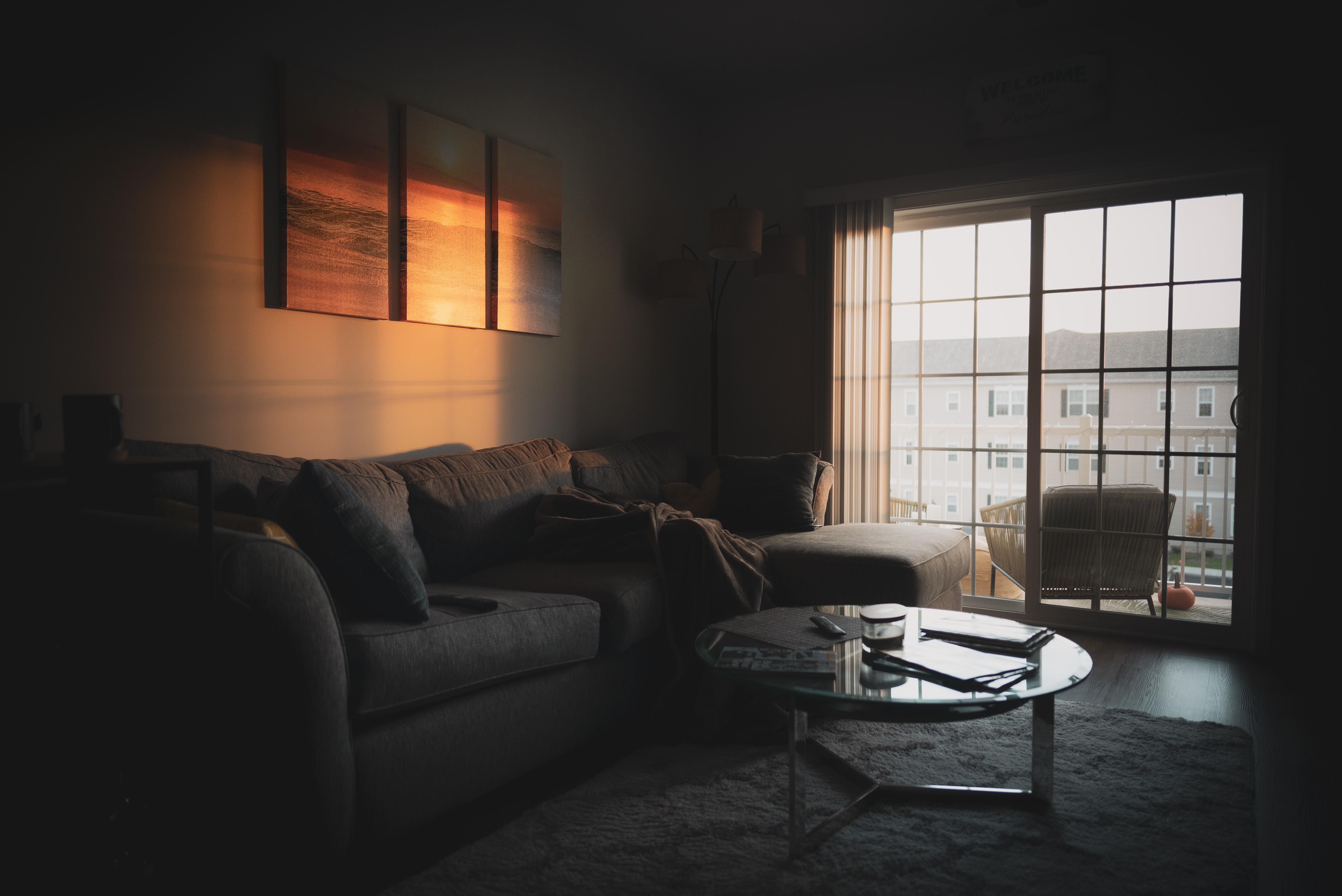 sectional sofa near coffee table and window