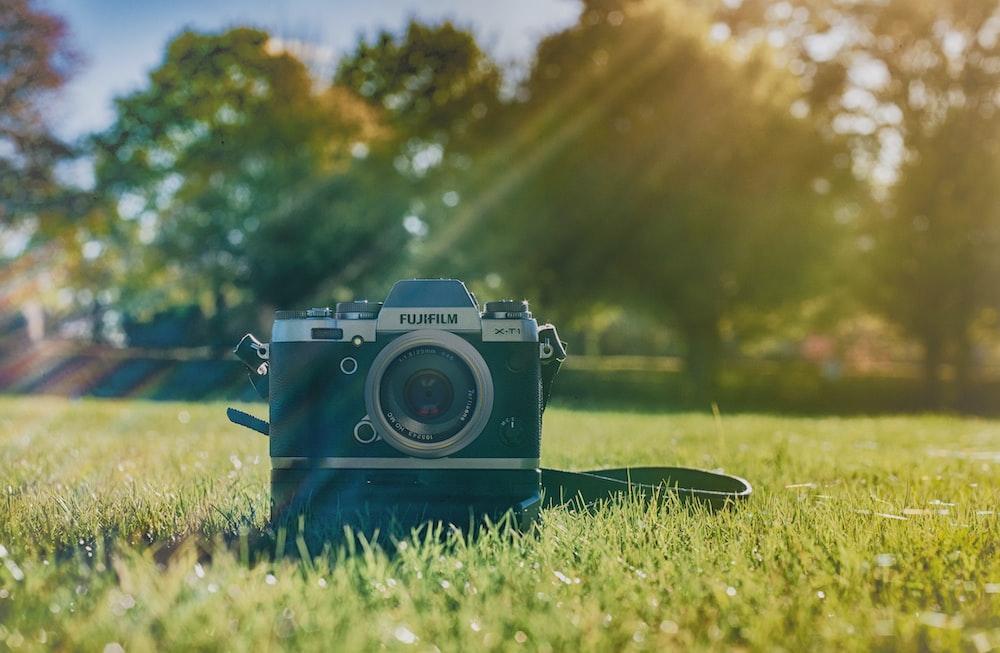 black Fujifilm camera on grass field