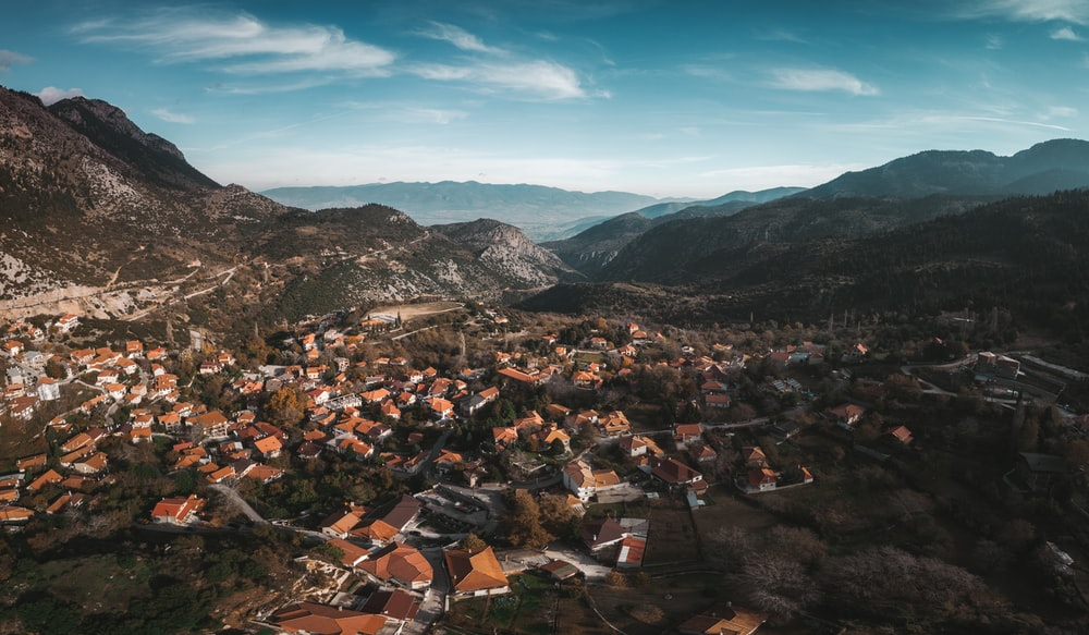 aerial photography of village surrounded by mountains