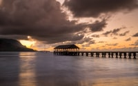 landscape photography of beach dock