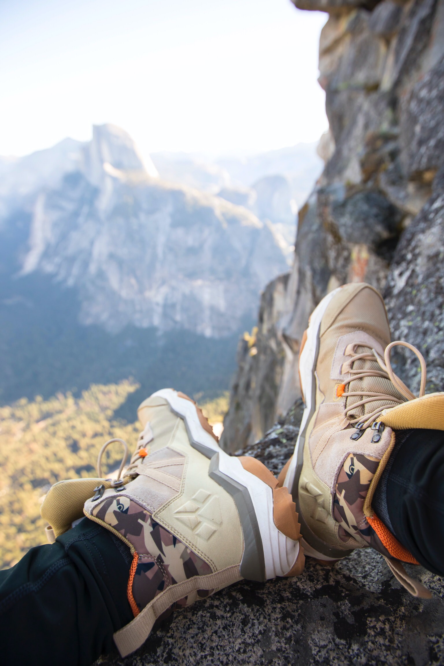 person wearing brown-and-white hiking shoes
