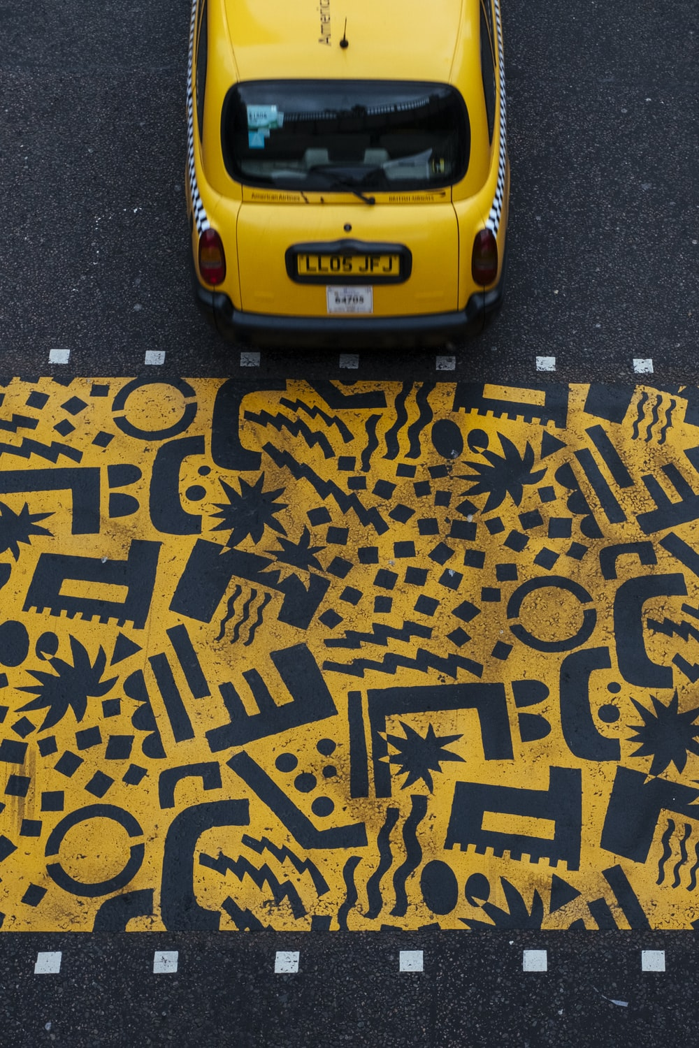 yellow vehicle parked at road during daytime