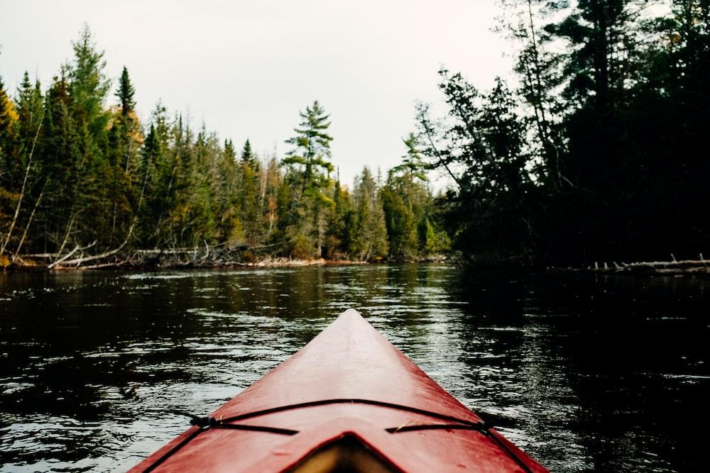 red kayak on river