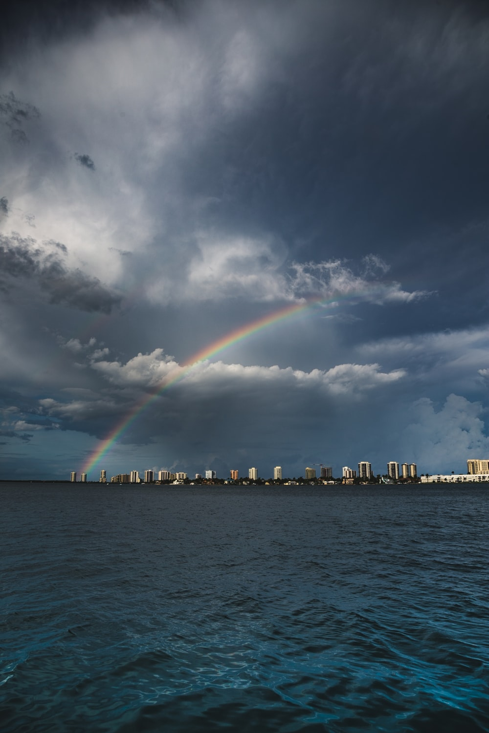rainbow over cityscape during daytime