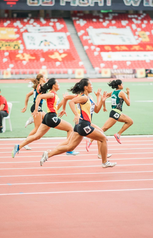 women running on track field