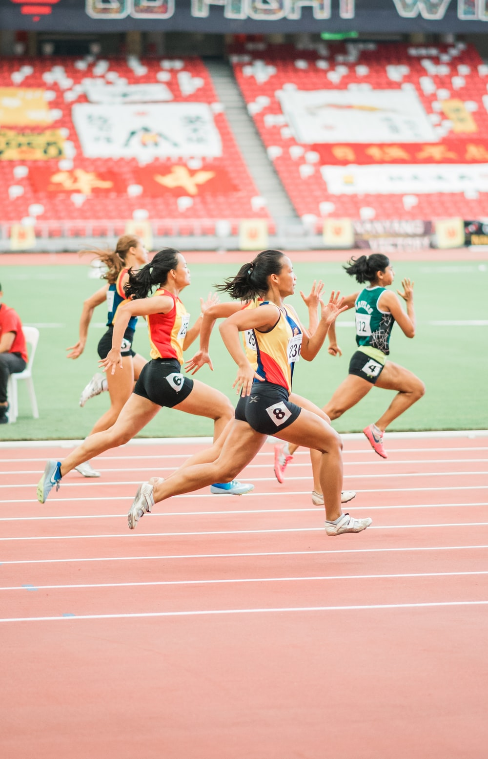 women running on track field