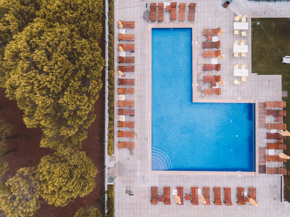 bird'eye-view photography of swimming pool near trees