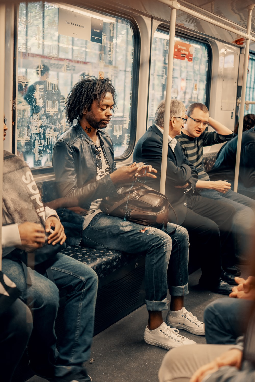 men riding train