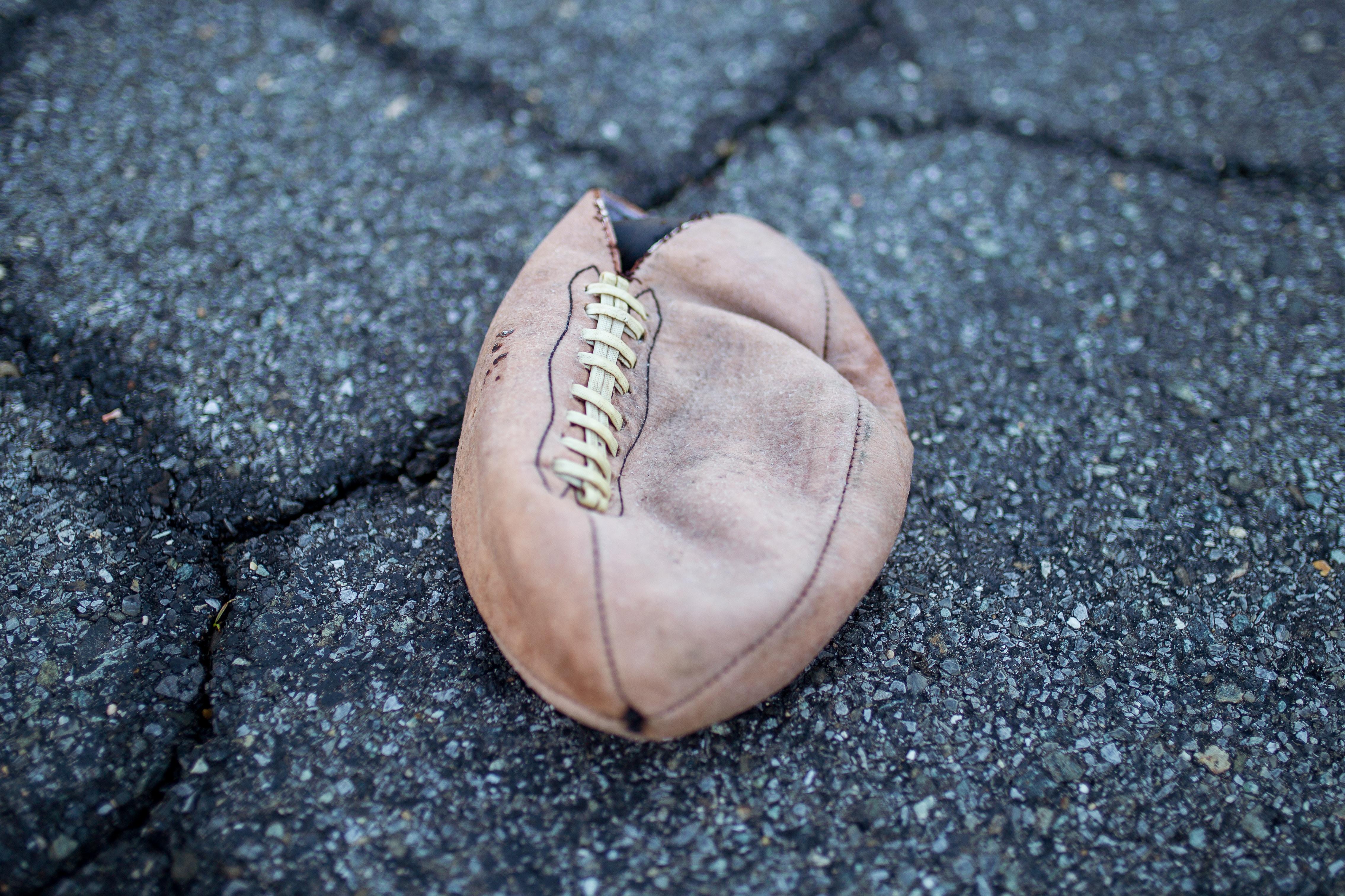 brown leather football on floor