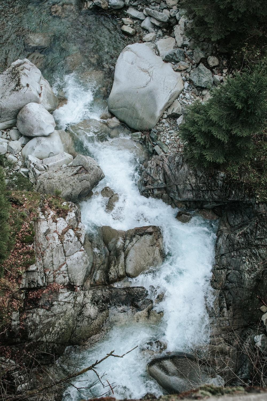 body of water in between rock formations