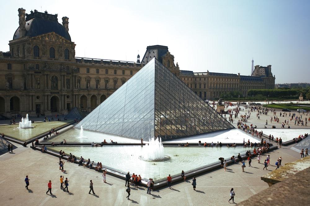 people walking around pyramid landmark
