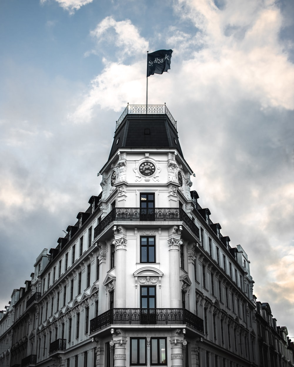 grayscale photography of castle with flag on top