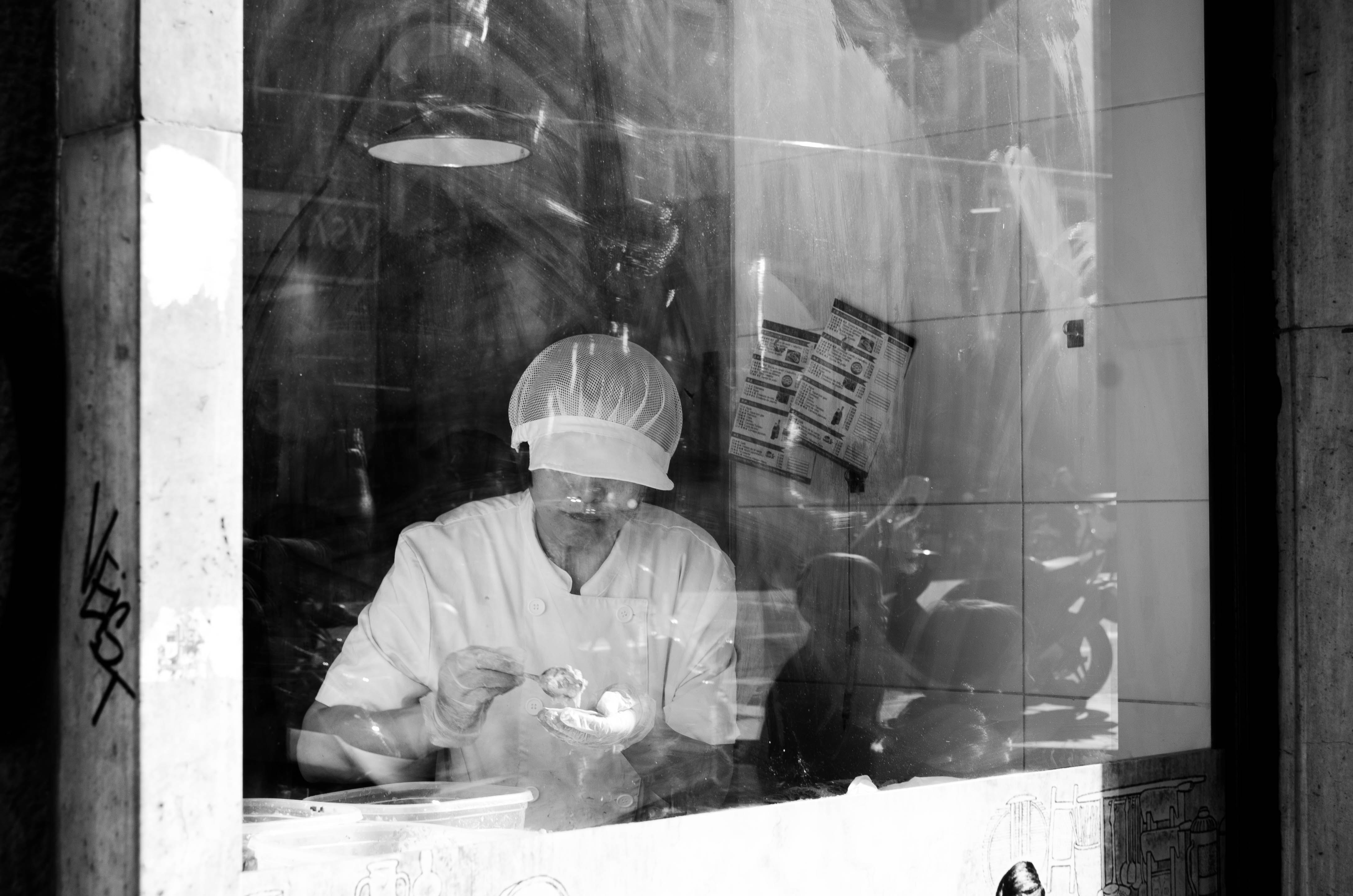 grayscale photography of person working inside room