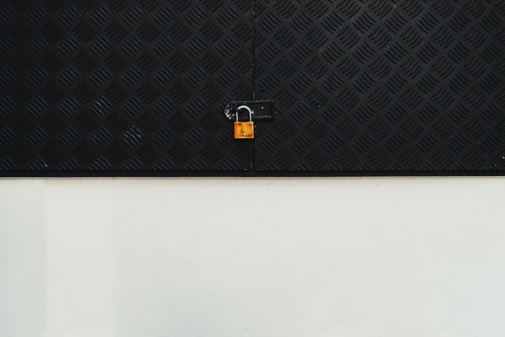 brass-colored padlock