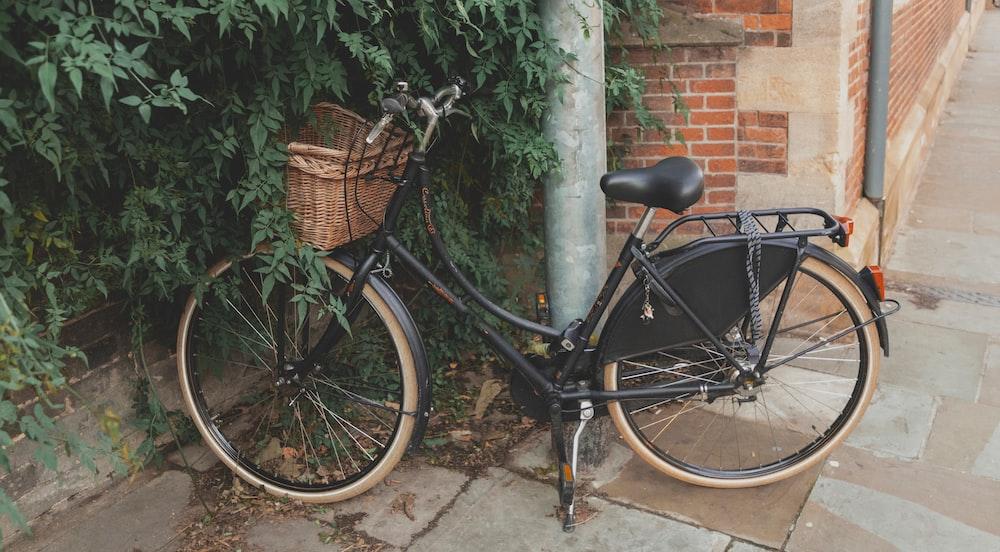 parked black commuter bike near building