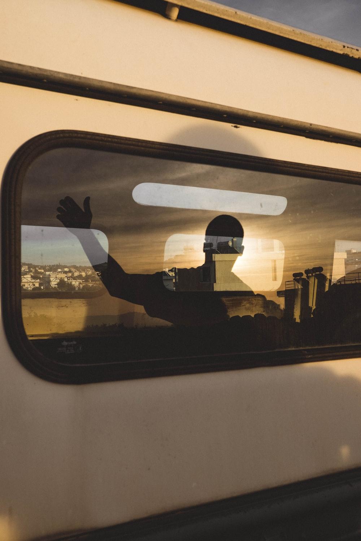human shadow reflecting on vehicle window