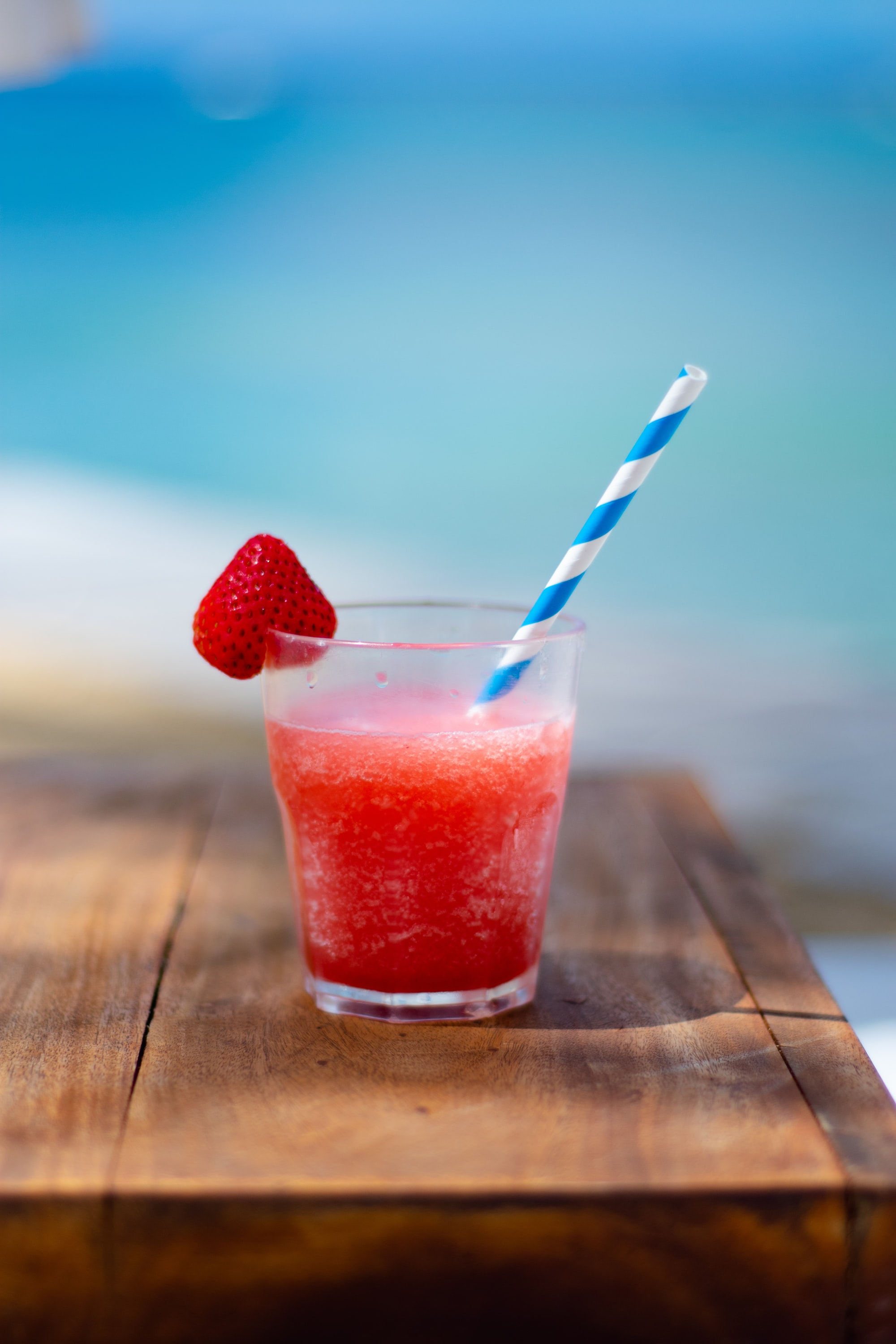 When the temperature is 93 degrees and you're sitting in the hot sun in Barbados, what better way to cool down then with a strawberry daiquiri? This is taken at Nikki Beach restaurant where there are breathtaking views of the sea all around. The beautiful blue sea creates a stunning background for this delicious drink.