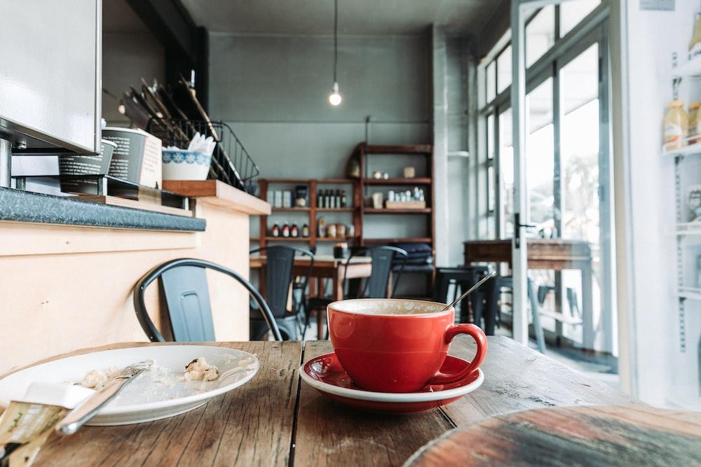 red ceramic teacup