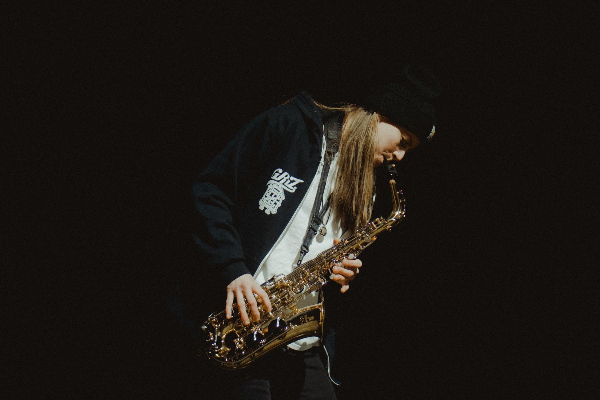EDM artist Grant Kwiecinski (a.k.a GRiZ) playing his saxophone.