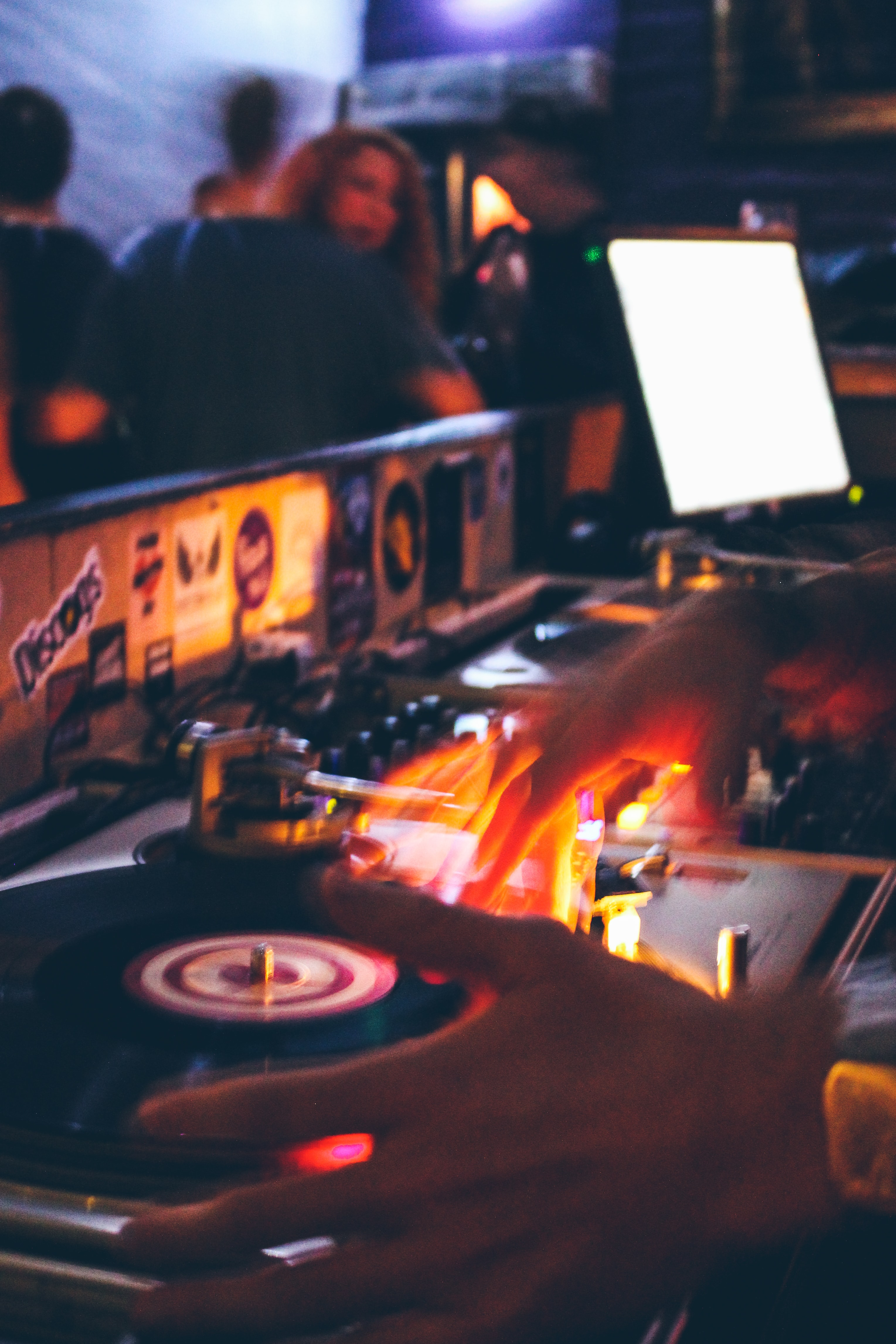 person holding black and grey DJ turntable